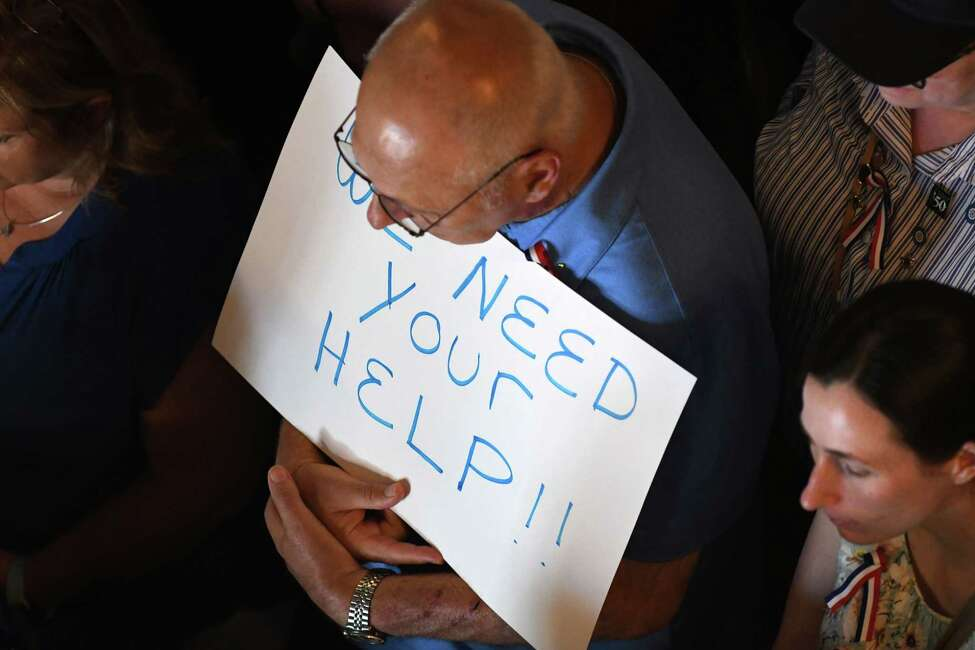 St. Clare's Hospital retirees and workers display signs during a press conference where lawmakers urged the state to launch an investigation of the hospital's pension fund collapse on Monday, June 17, 2019, at the Capitol in Albany, N.Y. Last year, over 1,000 former employees and retirees were notified their pensions would be eliminated or significantly decrease. (Will Waldron/Times Union)