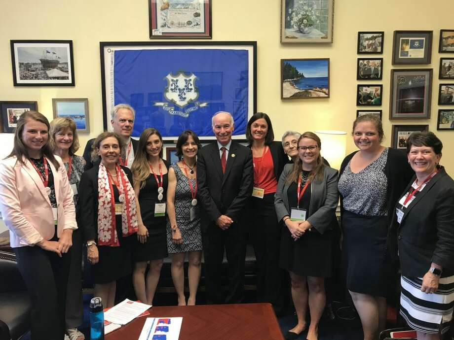 From left to right: Olivia Gastaldo, Phyllis Behlen, Lucinda Winslow, Bill Baker, Margaux Amara, Sandra Eagle, U.S. Rep. Joe Courtney, Kerry Morgan, Evelyn Avoglia, Molly Higbie, Beata Fogarasi (Courtney staffer), and Nancy Gardiner. — Margaux Amara photo