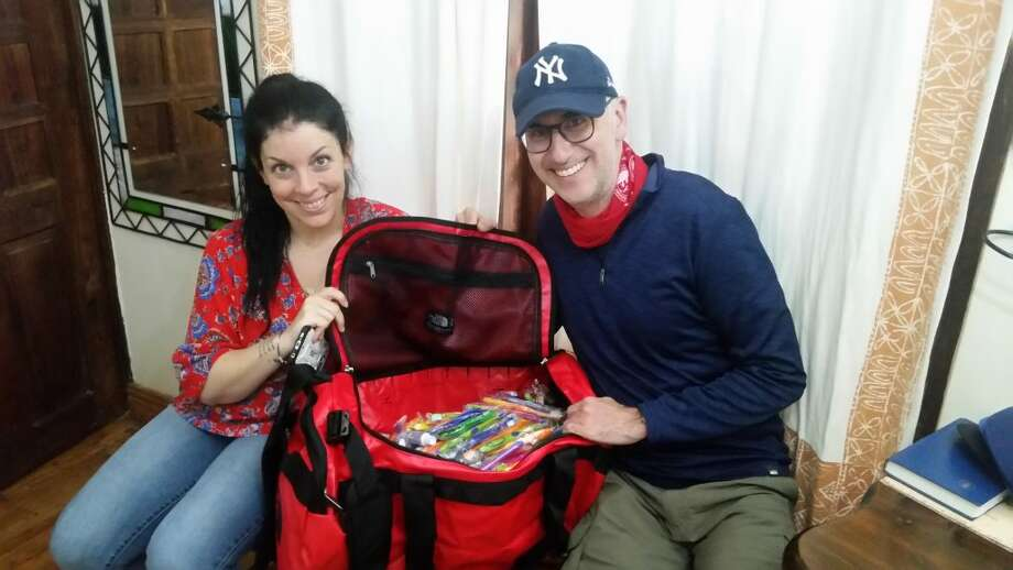 Ridgefield orthodontist Dr. Blaine Langberg brought toothbrushes with him during a recent trip to Africa.