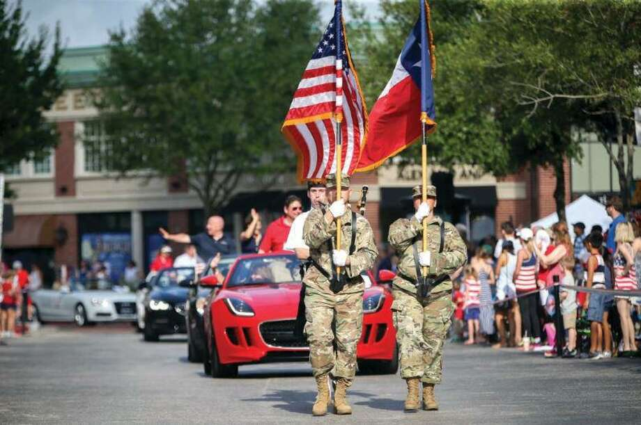 Parade participants march through Market Street during the a previous year's South County 4th of July Parade. This year, the 44th Annual South Montgomery County 4th of July parade is scheduled to begin at 9 a.m. Photo: File Photo / File Photo