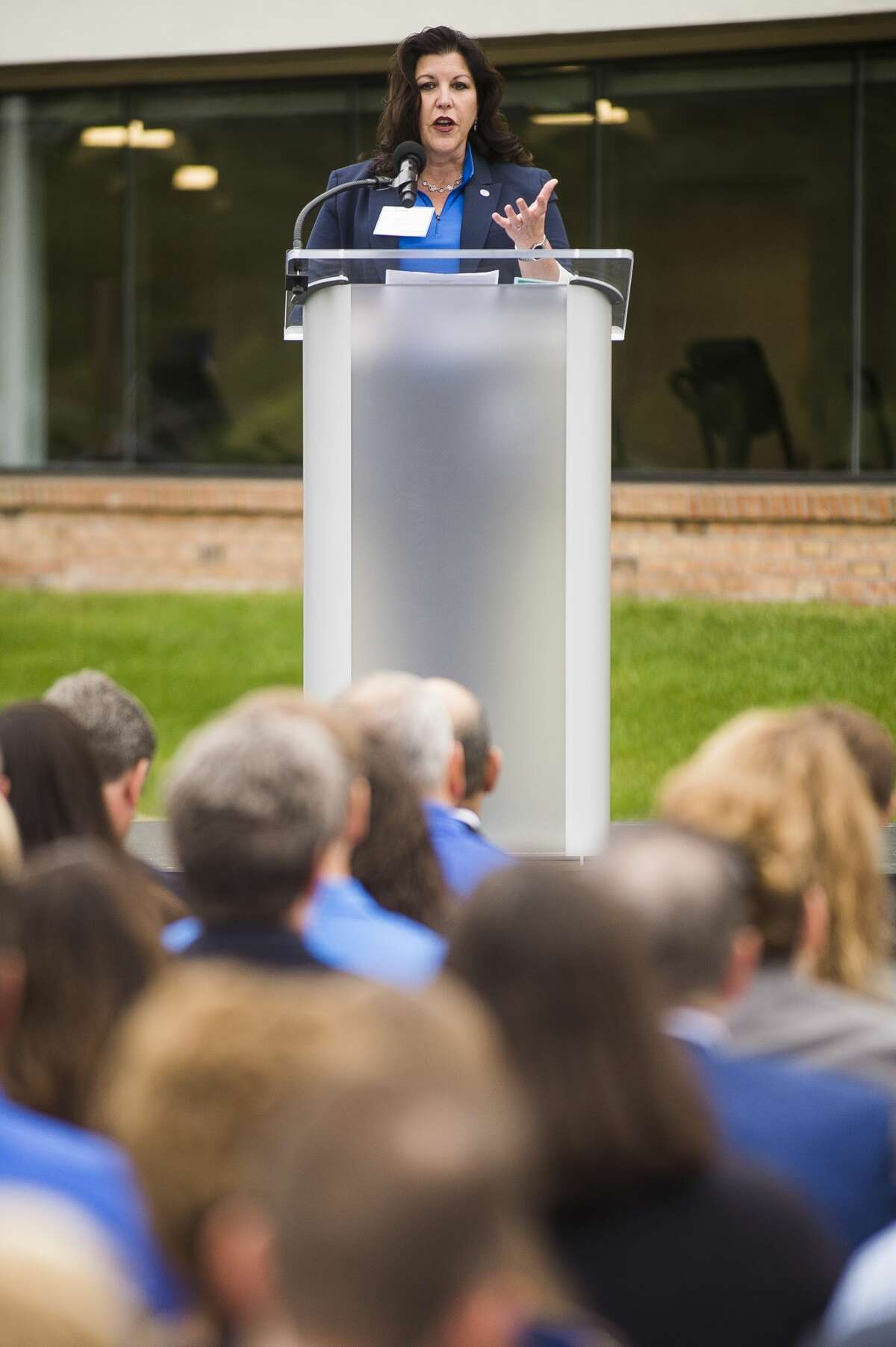 Guests listen as Susan Lewis, senior vice president of enterprise operations for Corteva Agriscience, speaks during an event celebrating the agriculture company on Monday, June 17, 2019 at 3100 James Savage Road in Midland. (Katy Kildee/kkildee@mdn.net)