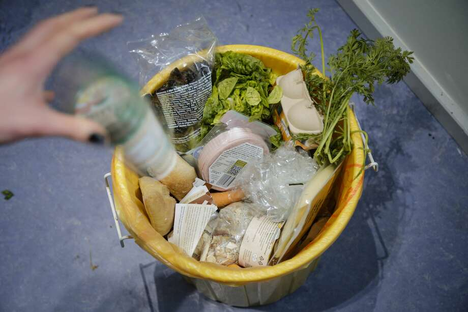 FILE - Expired foods are seen in a dustbin on Feb. 19, 2019 in Berlin, Germany. We take a look at where they came from, what they really mean and how the FDA and grocery manufacturers are working to change them. Photo: Thomas Trutschel/Photothek Via Getty Images