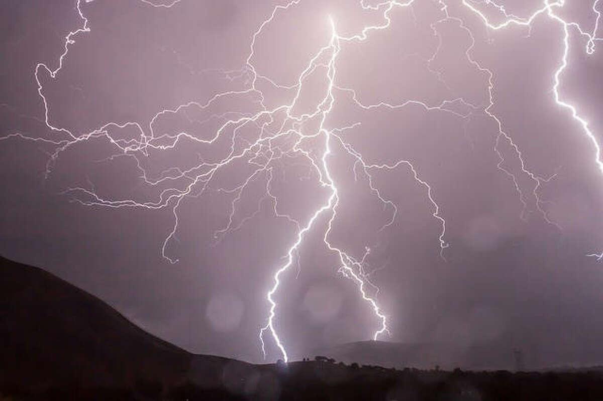 FILE - Lightning strikes
