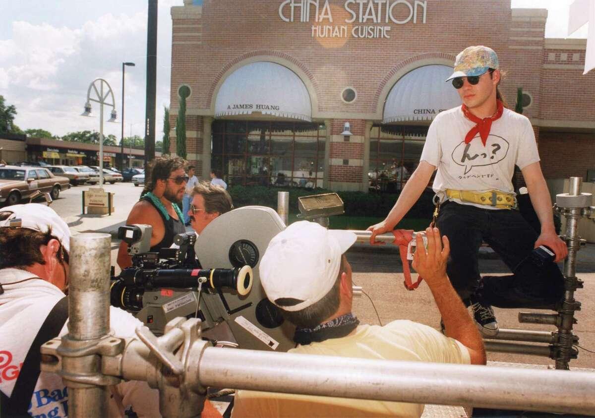Writer/director Adam Rifkin (far right) on location in Rice Village to shoot