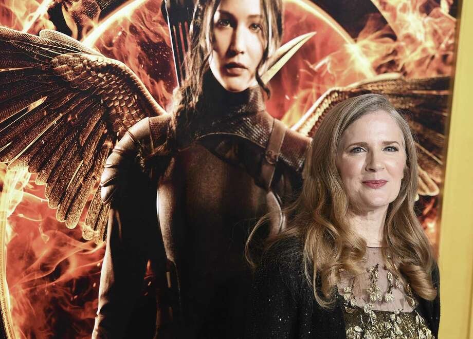 """FILE - In a Monday, Nov. 17, 2014 file photo, Suzanne Collins arrives at the Los Angeles premiere of """"The Hunger Games: Mockingjay - Part 1"""" at the Nokia Theatre L.A. Live. A decade after seemingly wrapping up """"The Hunger Games,"""" Suzanne Collins is bringing readers back to Panem. A prequel, set 64 years before the beginning of her multimillion-selling trilogy, is scheduled for release on May 19, 2020. (Photo by Jordan Strauss/Invision/AP, File) Photo: Jordan Strauss, INVL / Associated Press / Invision"""