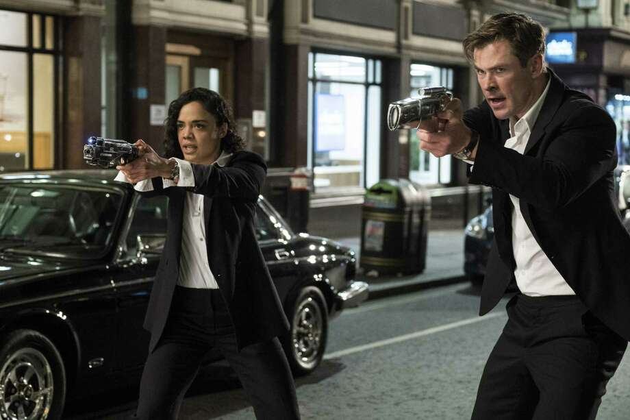 "This image released by Sony Pictures shows Tessa Thompson and Chris Hemsworth in a scene from Columbia Pictures' ""Men in Black: International."" (Giles Keyte/Sony/Columbia Pictures via AP) Photo: Giles Keyte, HONS / Associated Press / © 2018 CTMG, Inc. All Rights Reserved. **ALL IMAGES ARE PROPERTY OF SONY PICTURES ENTERTAINMENT INC. FOR PROMOTIONAL USE ONLY. S"