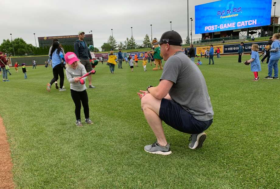 Fathers play catch on the field at Dow Diamond on Father's Day, June 16, 2019. (Photo provided/Ashley VanOchten, Great Lakes Loons) Photo: (Photo Provided/Ashley VanOchten, Great Lakes Loons)