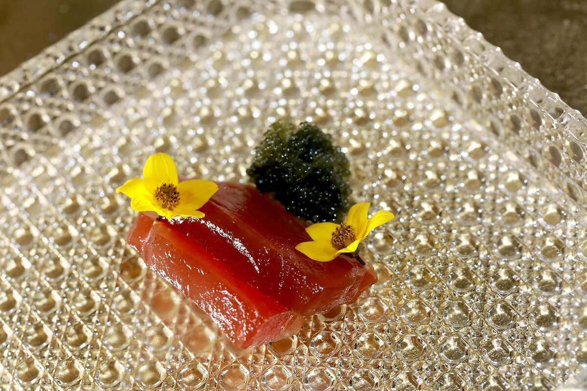 The Hatsu Katsuo dish at The Shota, located at 115 Sansome St., in San Francisco, Calif., on Thursday, May 23, 2019. It includes smoked Spring season skip jack tuna topped with sea grapes and sun daisy. For the condiments: pickled chrysanthemums, fresh wasabi, whole grain mustard, and pickled young spring onion bulb.