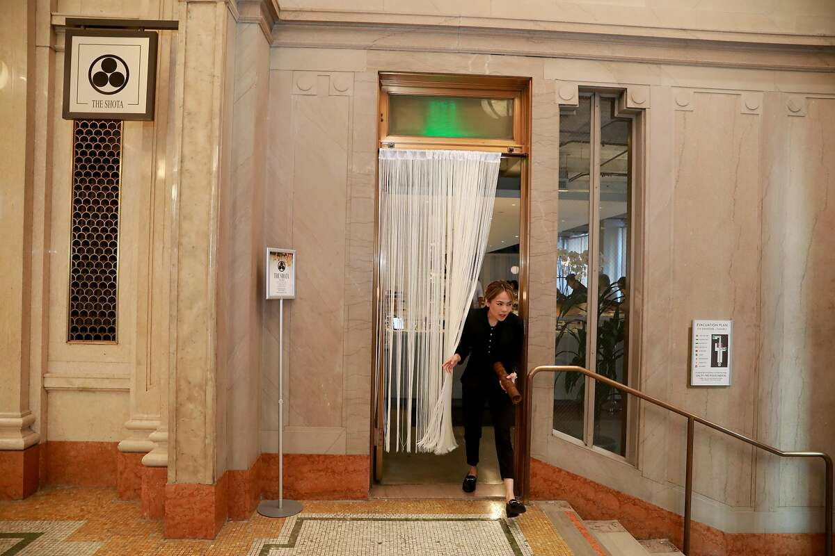 General manager Shar Guillermo exits the entrance of The Shota, located at 115 Sansome St., in San Francisco, Calif., on Thursday, May 23, 2019.