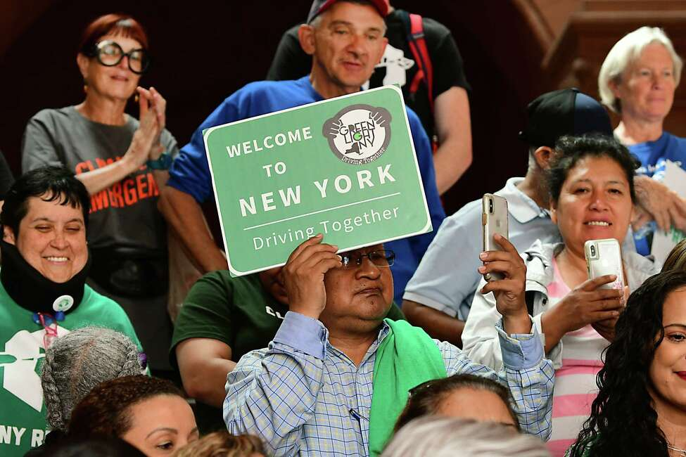 People rally in support of the greenlight bill which allows license for all at the New York State Capitol on Monday, June 17, 2019 in Albany, N.Y. (Lori Van Buren/Times Union)