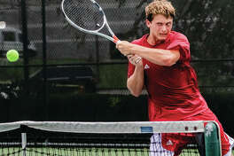 Carson Haskins makes a return to Kristopher Ortega in the Bud Simpson Open tennis tournament Men's Open Singles championship match last year at Lewis and Clark Community College. Haskins won 6-4, 6-4.