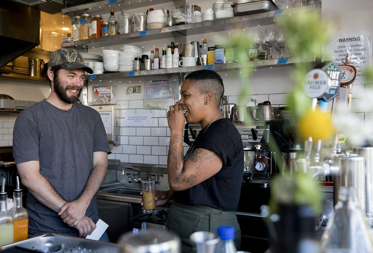 Bar director Will Adams and head chef Jesa Brooks chat behind the bar of Tamarack in Oakland, Calif. Saturday, June 8, 2019.