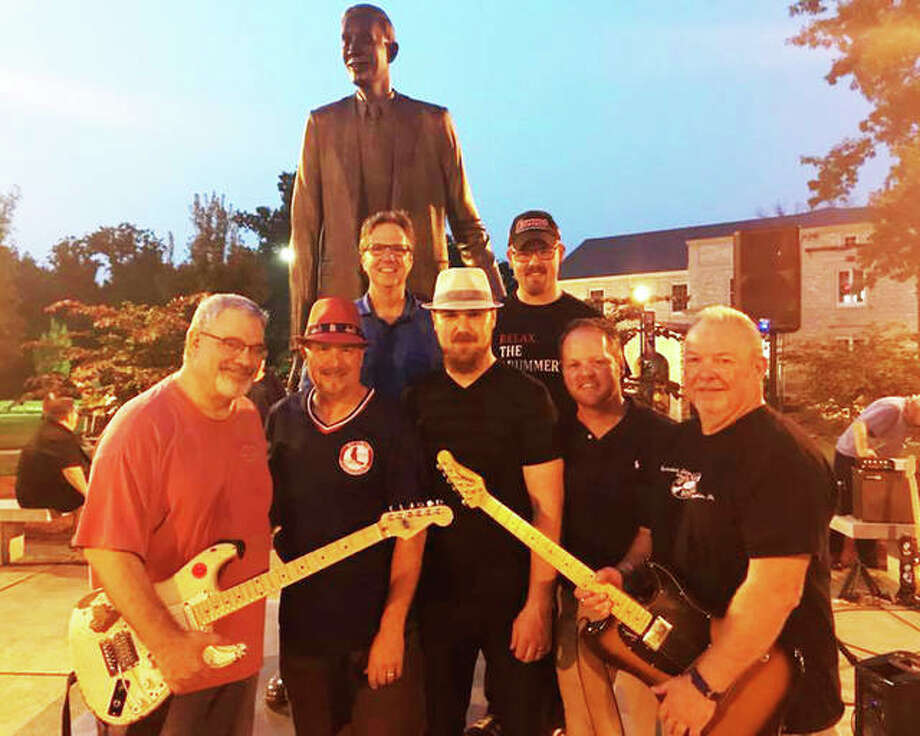 "Bud Summers, front right, with friends, from front left, John Mondin, Marc Waters, Jason McAttee, and John Hand in front of the Robert Wadlow statue on the SIUE Dental Campus in Upper Alton during last year's ""Rockin' with Robert"" summer concert series hosted by the Upper Alton Association. This year's series begins Tuesday, June 18. Photo: Courtesy Of The Upper Alton Association"