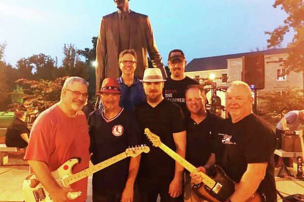 """Bud Summers, front right, with friends, from front left, John Mondin, Marc Waters, Jason McAttee, and John Hand in front of the Robert Wadlow statue on the SIUE Dental Campus in Upper Alton during last year's """"Rockin' with Robert"""" summer concert series hosted by the Upper Alton Association. This year's series begins Tuesday, June 18."""