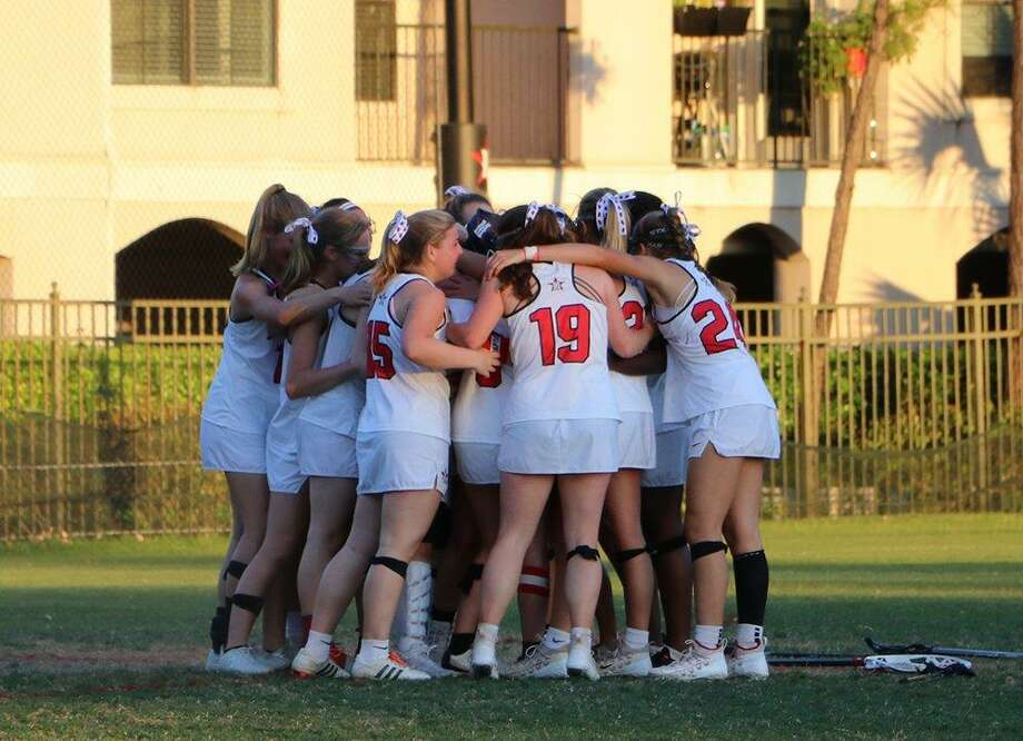 The St. John's School girls lacrosse team advanced to the city championship game and state semifinals, earning four TGHSLL all-state spots as goalie Mary Leonard, midfielder Katina Christenson, attacker Caroline Pressler and defender Kate Ainbinder made the list. Photo: St. John's School / St. John's School