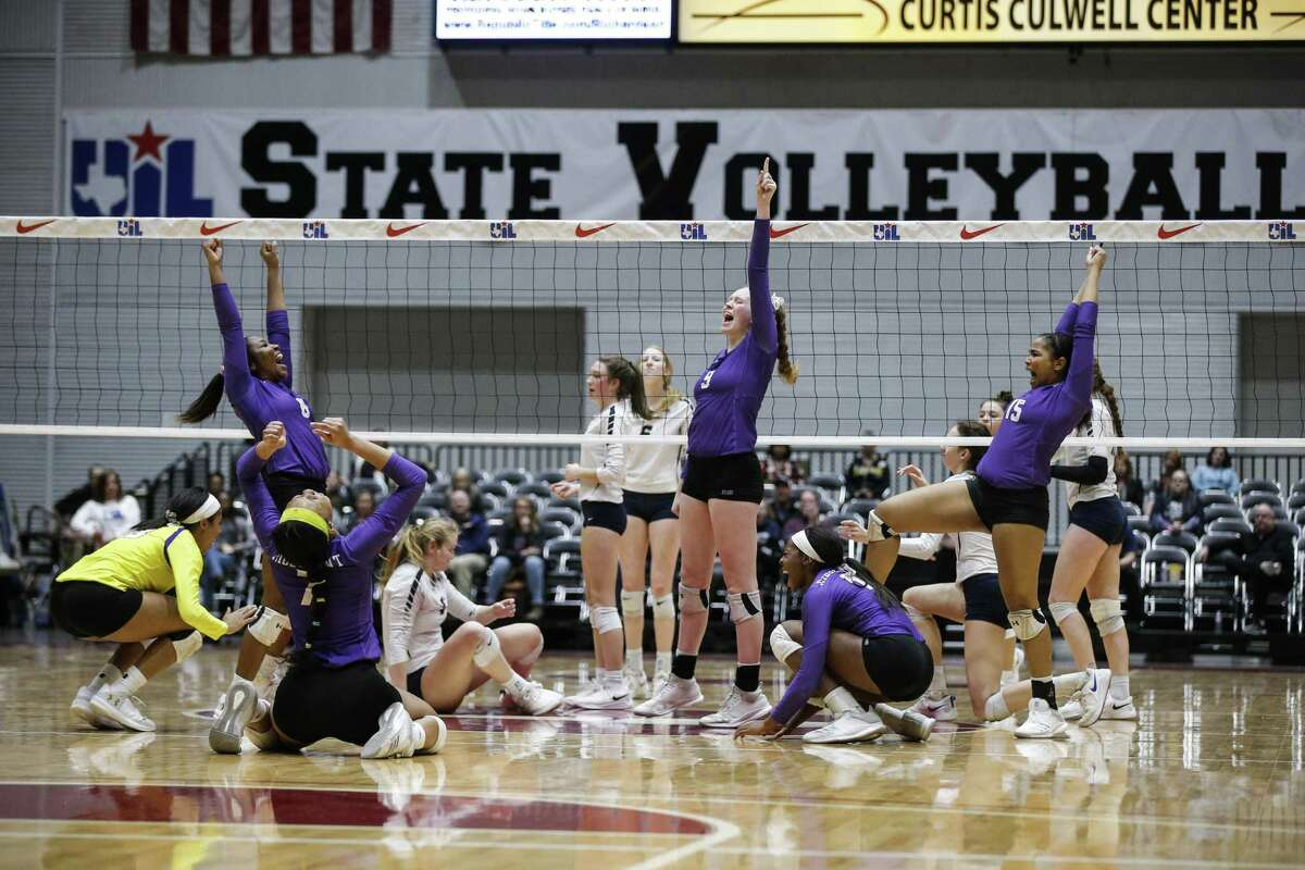 Ridge Point celebrates a point during a Class 6A State Championship volleyball game against Flower Mound at the Curtis Culwell Center in Garland, Texas, Nov. 17, 2018.