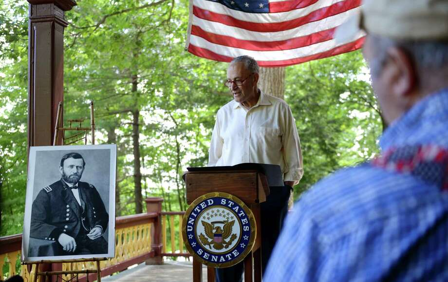 U.S. Senator Charles E. Schumer, center, calls on the National Parks Service (NPS) to designate the U.S. Grant Cottage State Historic Site a National Historic Landmark to a group of members of the board of trustees for the site and local elected officials on Monday, June 17, 2019 at Ulysses S. Grant Cottage State Historic Site in Wilton, N.Y.  Schumer emphasized that the designation would further protect the historical integrity of Grant Cottage and the surrounding Adirondack Mountains by opening up increased opportunities for federal preservation funding for the site. (Catherine Rafferty/Times Union) Photo: Catherine Rafferty, Albany Times Union / 40047267A