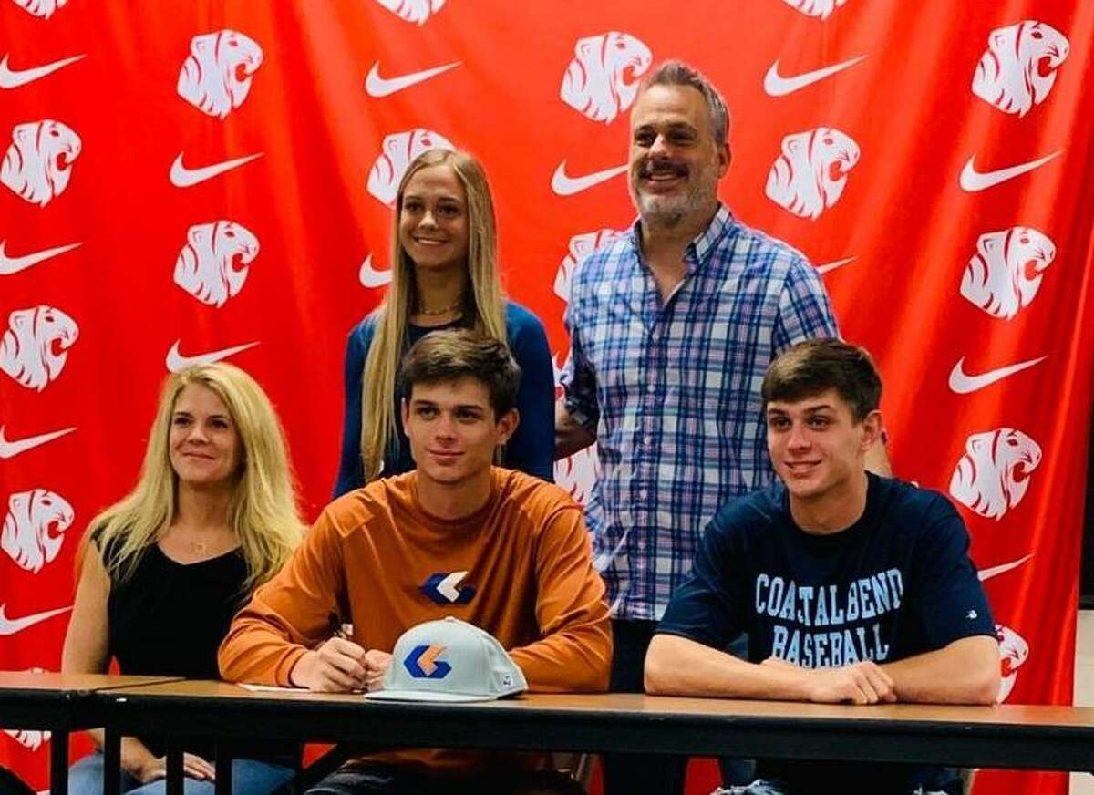 Katy senior outfielder Hayden Blair celebrates with family after signing a baseball scholarship with Galveston College this spring. Blair was also a first-team all-district selection after leading the Tigers to the area playoffs.