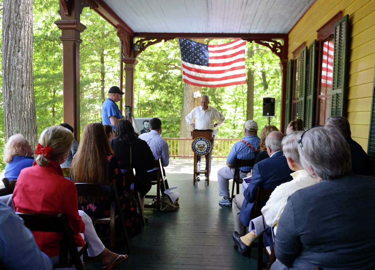 U.S. Senator Charles E. Schumer, center, calls on the National Parks Service (NPS) to designate the U.S. Grant Cottage State Historic Site a National Historic Landmark to a group of members of the board of trustees for the site, local elected officials and local media on Monday, June 17, 2019 at Ulysses S. Grant Cottage State Historic Site in Wilton, N.Y. Schumer emphasized that the designation would further protect the historical integrity of Grant Cottage and the surrounding Adirondack Mountains by opening up increased opportunities for federal preservation funding for the site. (Catherine Rafferty/Times Union)