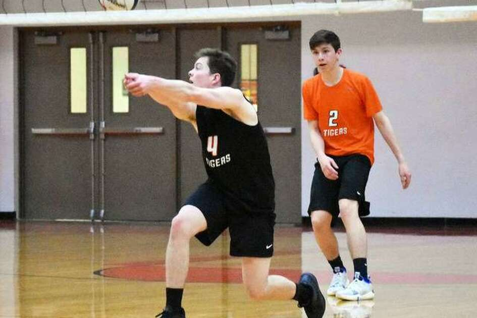 Edwardsville's Max Sellers bumps the ball during action against Belleville East in Southwestern Conference action.