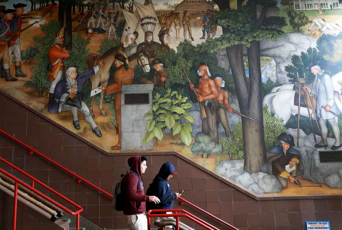 The historic mural depicts the treatment of American Indians and African Americans.