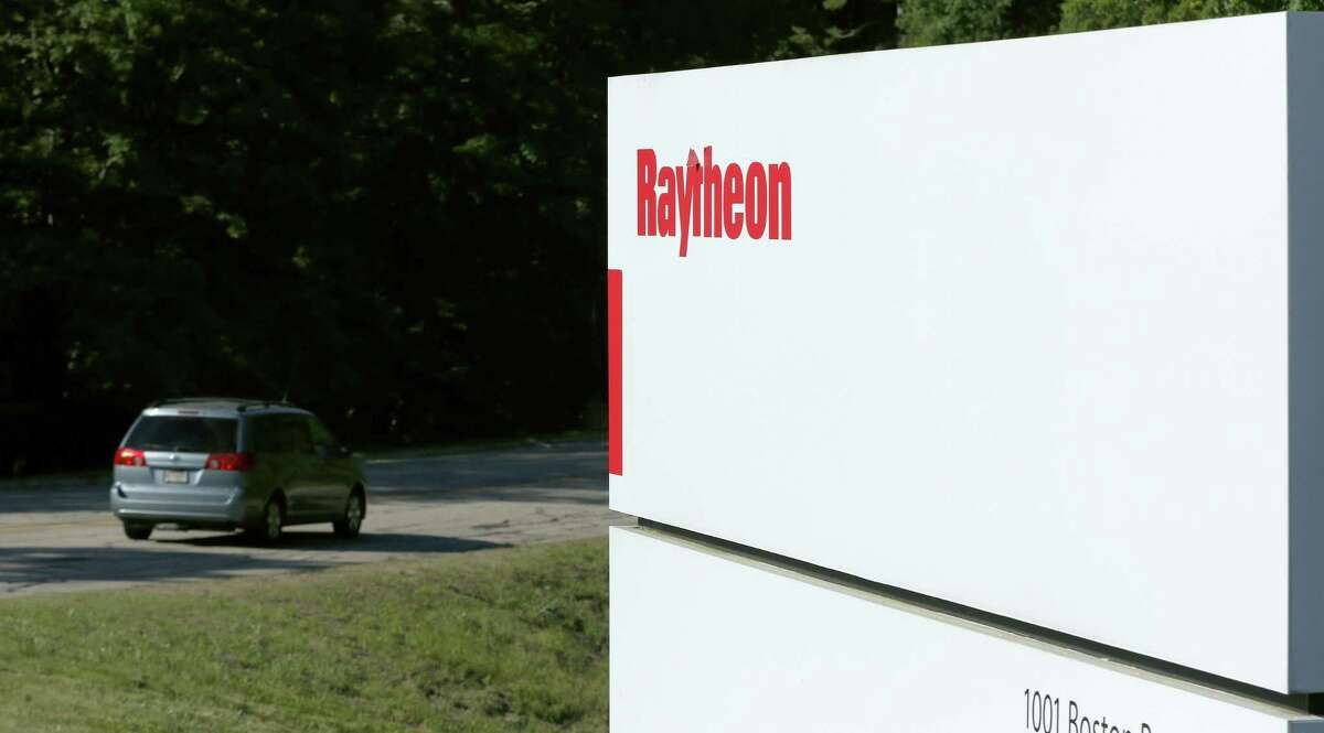 Workers drive into the Raytheon facility Monday, June 10, 2019, in Marlborough. Raytheon Co. and United Technologies Corp. are merging in a deal that creates one of the world's largest defense companies. (AP Photo/Bill Sikes)
