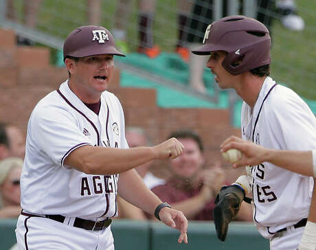 FILE - In this June 9, 2017, file photo, Texas A&M third base coach Will bolt, left, cheers Braden Shewmake (8) who slid into third base in the 15th inning of an NCAA college baseball tournament super regional game against Davidson in College Station, Texas. Texas A&M assistant Bolt is returning to Nebraska to become the Cornhuskers' head baseball coach. Nebraska athletic director Bill Moos announced the hiring Friday, June 14, 2019. (AP Photo/Michael Wyke, File)