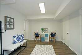 The oversized full finished lower level has multiple rooms with versatile use of each room, and a full bath.