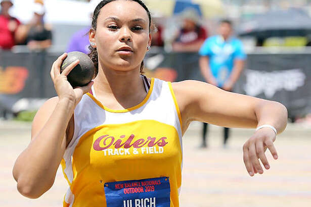 Jayden Ulrich of East Alton-Wood River High School competes in the shot put Sunday at the New Balance National Outdoor Meet in Greensboro, N.C. Ulrich's fifth-place finish earned her All-America status.