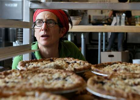 Karen Heisler, the co-owner of Mission Pie, checks the pie inventory, Friday, March 13, 2015, in San Francisco, Calif.