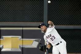 HOUSTON, TEXAS - MAY 25: Michael Brantley #23 of the Houston Astros throws the ball back in from center field after a single in the sixth inning against the Boston Red Sox at Minute Maid Park on May 25, 2019 in Houston, Texas. (Photo by Bob Levey/Getty Images)