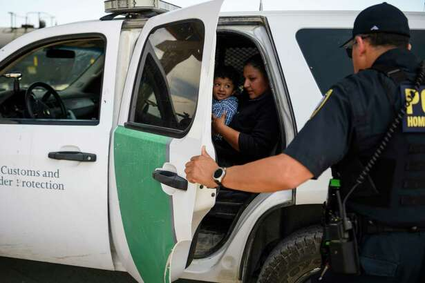 Gabriela Pinelo and her son Gervin, 3, of Guatemala, prepare to be transported by U.S. Border Patrol agents in El Paso on June 13, 2019.