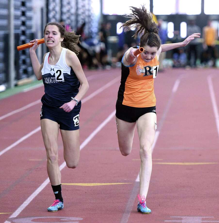 Taylor Mascetta (left) of Immaculate edges out Grace Michalowski of Ridgefield at the finish line in the 4x800 meter relay at the State Open track championship at the Floyd Little Athletic Center in New Haven on February 16. Photo: Arnold Gold / Hearst Connecticut Media / New Haven Register