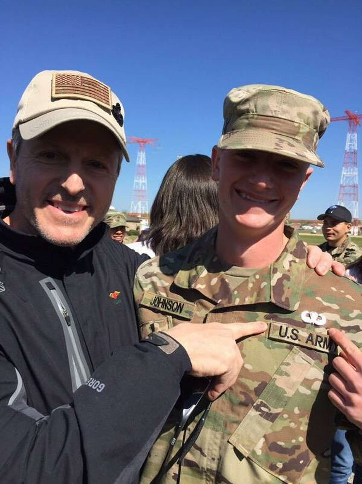 Retired Army Col. Samuel Johnson points to the Parachutist Badge he pinned on his son Pvt. Bradley upon graduation from Airborne School at Fort Benning, Ga. That same badge was earned and worn by Bradley?s late grandfather, retired Col. Charlie Johnson and dad, Samuel. (Provided)