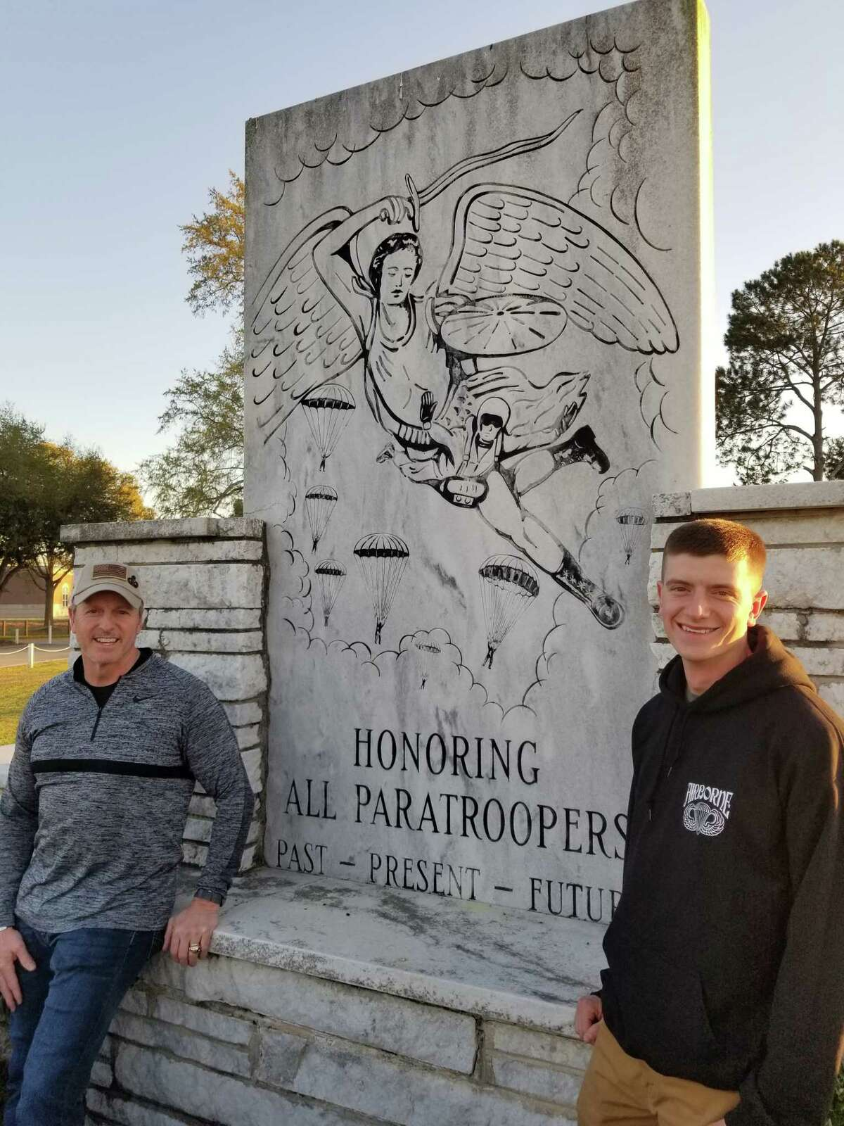 Retired Army Col. Samuel Johnson and his son Bradley, both Army paratroopers visit an airborne monument at Fort Benning, Ga. (Provided)