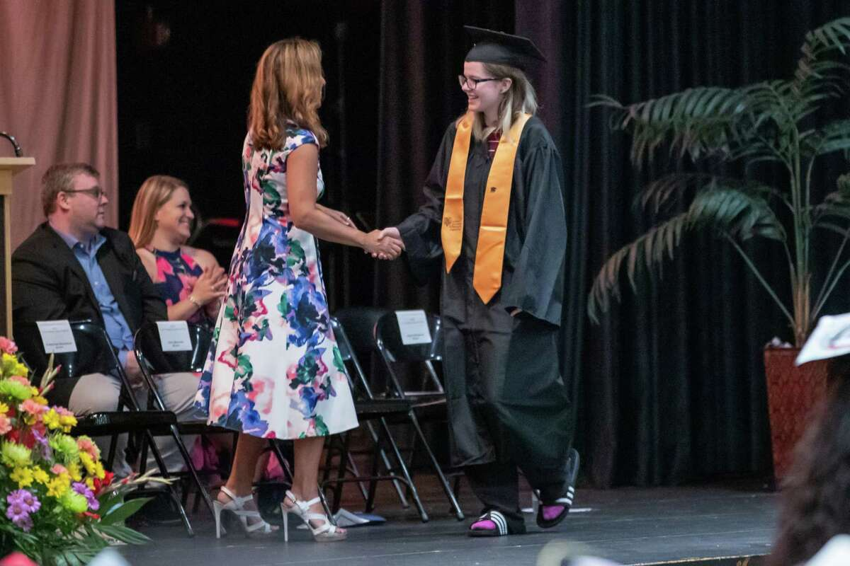 Faculty greet and congratulate graduating seniors at the graduation for the class of 2019 for the Academy of Information Technology & Engineering on June 17, 2019 at the Rippowam Auditorium in Stamford, CT.