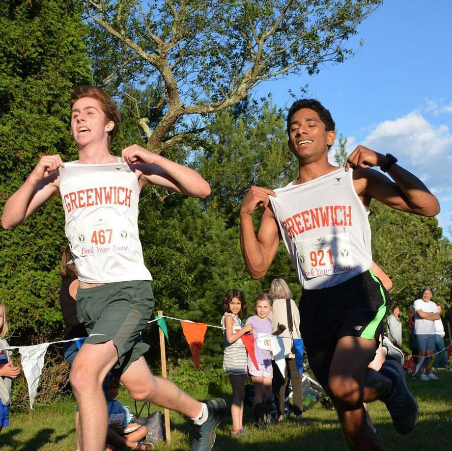 Aidan Brock, left, and Christopher Fenaroli, placed first and second, respectively, on Friday at the 2019 Garden Catering Cook Your Buns Family Fun Run at Greenwich Point. Photo: Contributed Photo / Greenwich Time Contributed