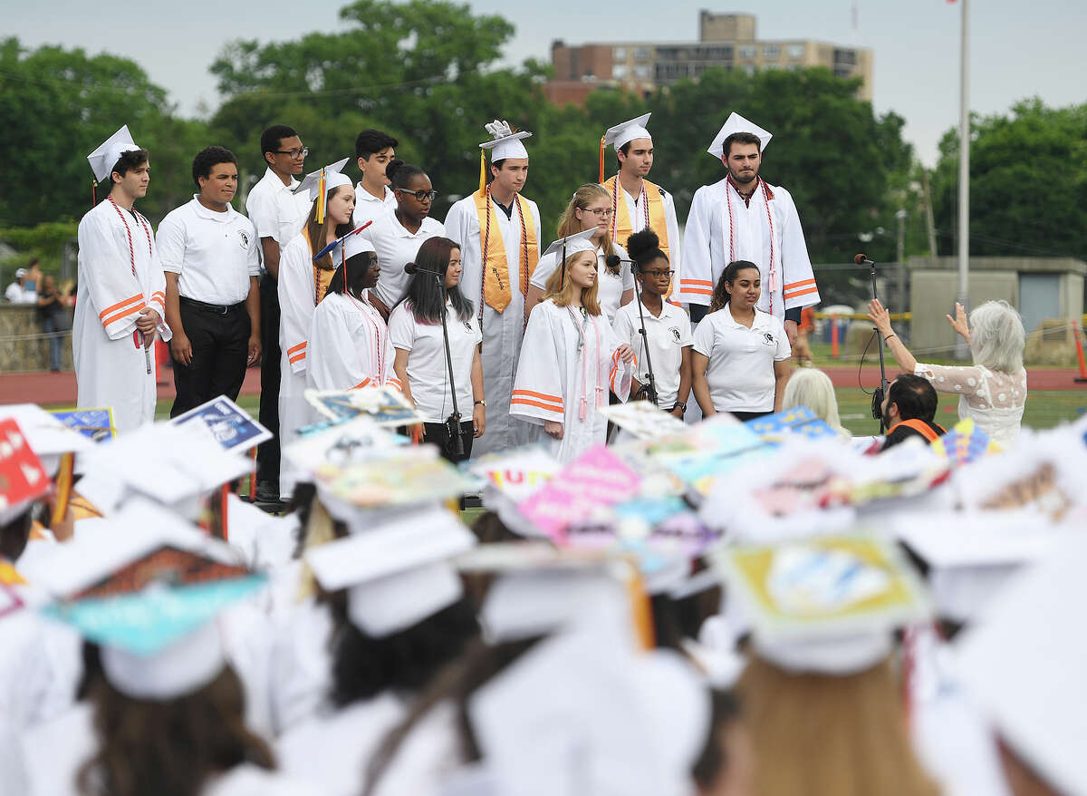 The Madrigal Singers and Concert Choir members perform at the Stamford High School Graduation in Stamford, Conn. on Monday, June 17, 2019.