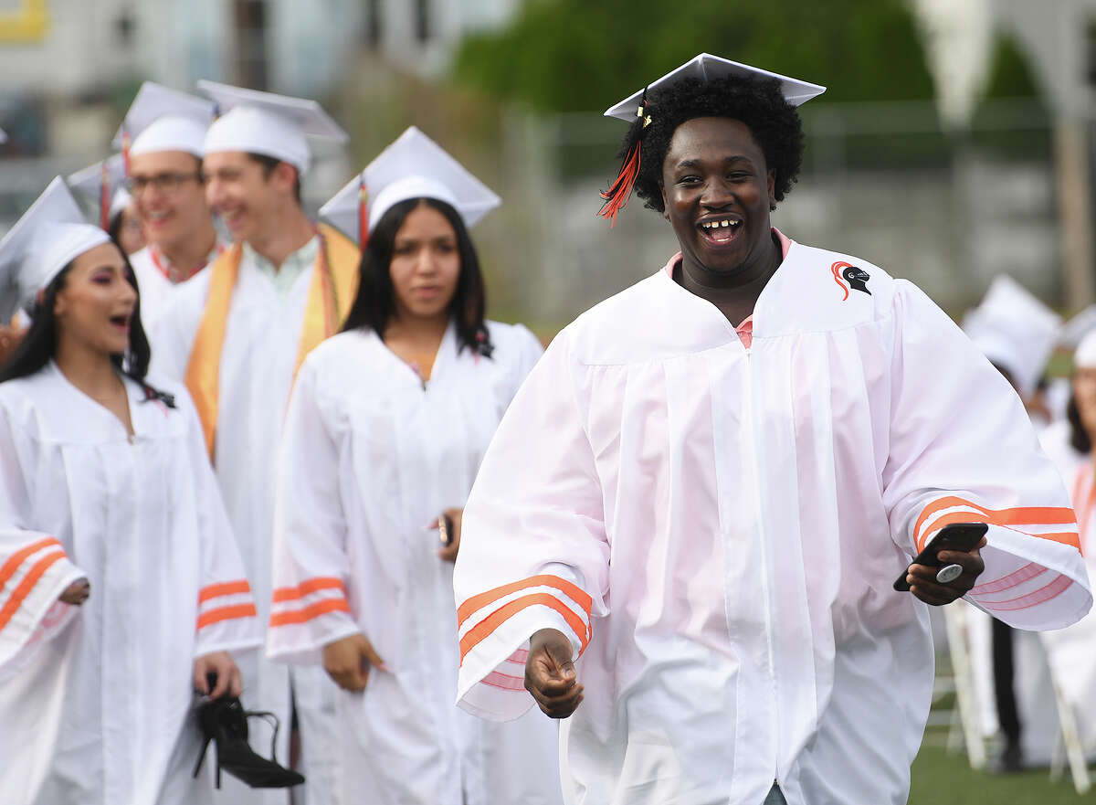 Graduate Khamar Brown breaks into a big smile as he walks up to receive his diploma at the Stamford High School Graduation in Stamford, Conn. on Monday, June 17, 2019.