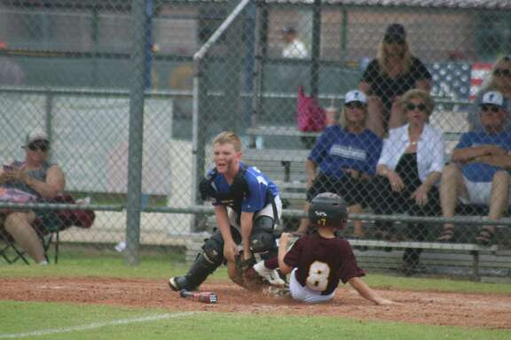 Deer Park's Dom Benvin slides home with a sixth-inning run. His leadoff single helped his teammates score three insurance runs.