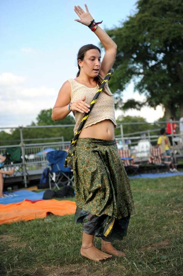 Michelle Sacco of Gettysburg, Penn., hula hoops during the Gathering of the Vibes concert at Seaside Park on Thursday, July 29, 2010. Photo: Lindsay Niegelberg / Connecticut Post