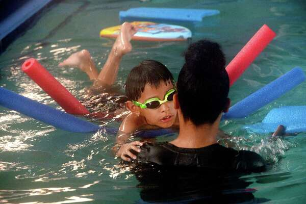 Richard Flores, III, works with swim instructor LaTonya Cargin during the swimming lessons for special needs children at the Shorkey Center. Learning to be safe in the water is especially critical for children with Autism Spectrum Disorder, who tend to be drawn to water, and who are at a statistically higher risk of drowning. Photo taken Monday, June 17, 2019 Kim Brent/The Enterprise