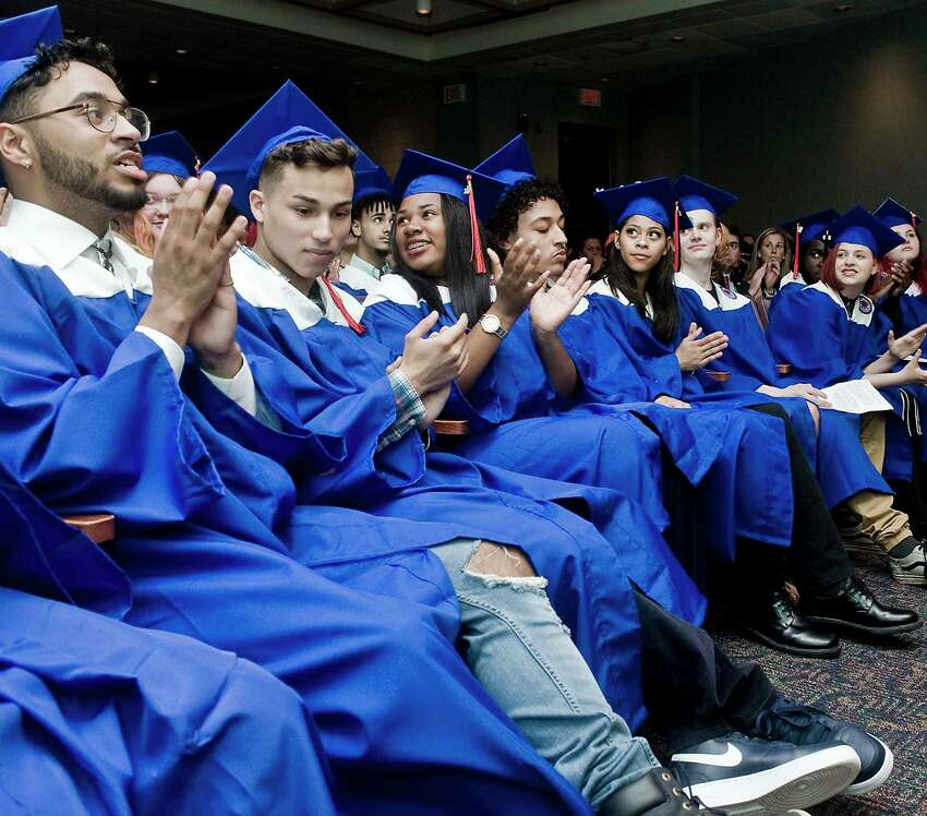 Alternative School for Excellence (ACE) graduates applaud a guest speaker during the graduation ceremony at WestConn's Midtown Student Center. Monday, June 17, 2019