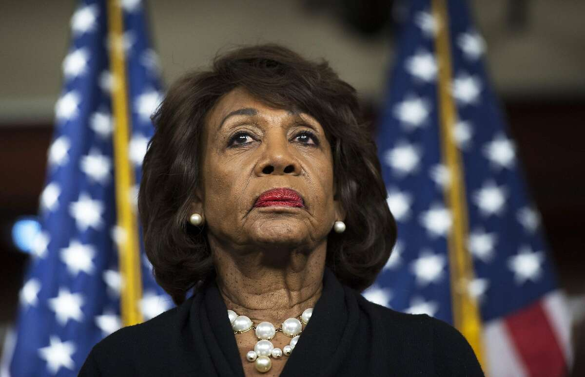 (FILES) In this file photo taken on January 09, 2018, US Representative Maxine Waters (D-CA) looks on before speaking to reports regarding the Russia investigation on Capitol Hill in Washington, DC.