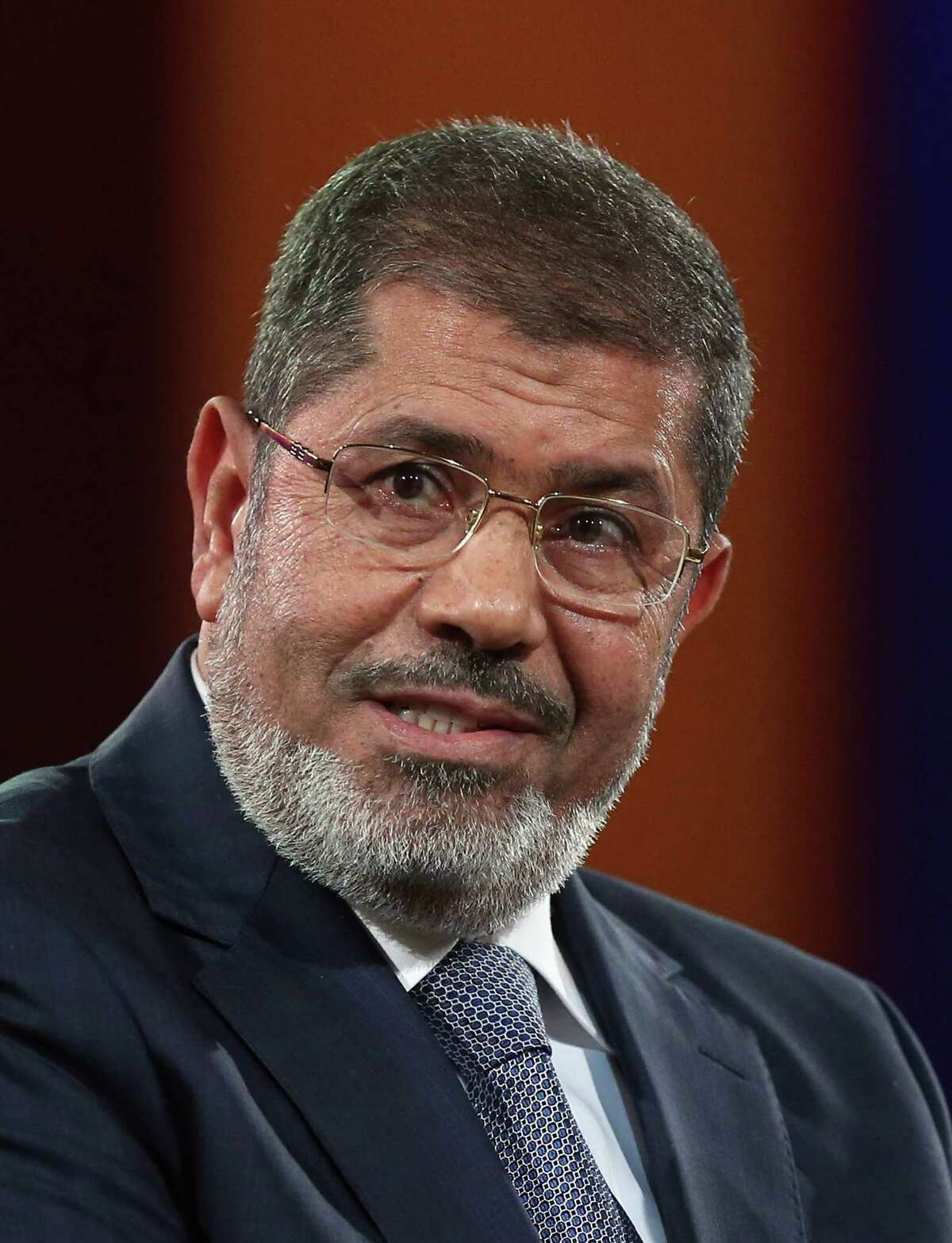 FILE - JUNE 17, 2019: According to state TV, ousted Egyptian President Mohammed Morsi has died at the age of 67 after fainting in a courtroom. NEW YORK, NY - SEPTEMBER 25: Egyptian President Mohamed Morsi speaks at the Clinton Global Initiative meeting on September 25, 2012 in New York City. Timed to coincide with the United Nations General Assembly, CGI brings together heads of state, CEOs, philanthropists and others to help find solutions to the world's major problems. (Photo by Mario Tama/Getty Images)