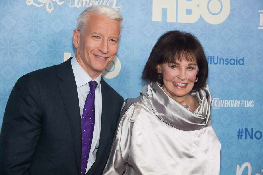 "FILE - In this April 4, 2016 file photo, CNN anchor Anderson Cooper and Gloria Vanderbilt attend the premiere of ""Nothing Left Unsaid"" at the Time Warner Center in New York. Vanderbilt, the ""poor little rich girl"" heiress at the center of a scandalous custody battle of the 1930s and the designer jeans queen of the 1970s and '80s, died on Monday, June 17, 2019, at 95, according to her son, Cooper. (Photo by Charles Sykes/Invision/AP, File) Photo: Charles Sykes / Invision"