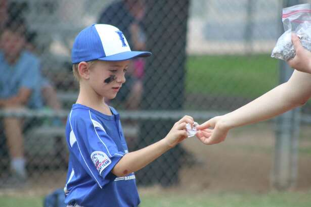 Friendswood's Noah Regner receives his Directors Tournament ring, following Sunday afternoon's championship game at Renwick Park.