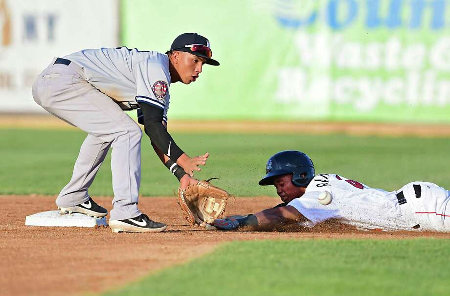 Tri-City ValleyCats' Yeuris Ramirez slides safely under the tag of Staten Island Yankees' Oswald Peraza during a baseball game against at Joe Bruno Stadium on Monday, June 17, 2019 in Troy, N.Y. (Lori Van Buren/Times Union) Photo: Lori Van Buren, Albany Times Union / 40047107A