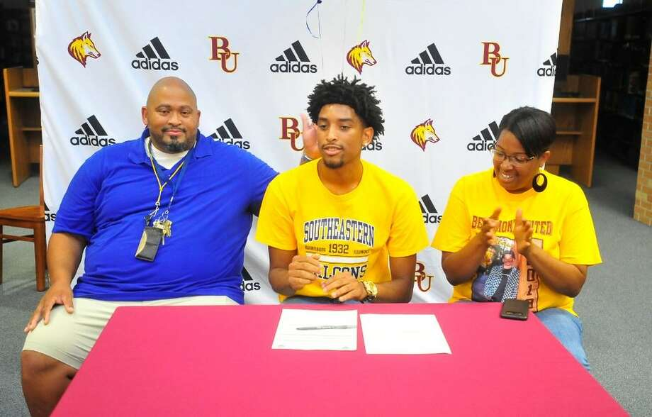 Kevin Dotson Jr. became the first Beaumont United boys basketball player to sign with a college team on Monday night inside the school's library. He'll attend Southeastern Illinois next year. Photo by Matt Faye/The Enterprise. Photo: Matt Faye/The Enterprise