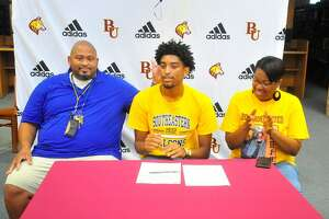 Kevin Dotson Jr. became the first Beaumont United boys basketball player to sign with a college team on Monday night inside the school's library. He'll attend Southeastern Illinois next year. Photo by Matt Faye/The Enterprise.